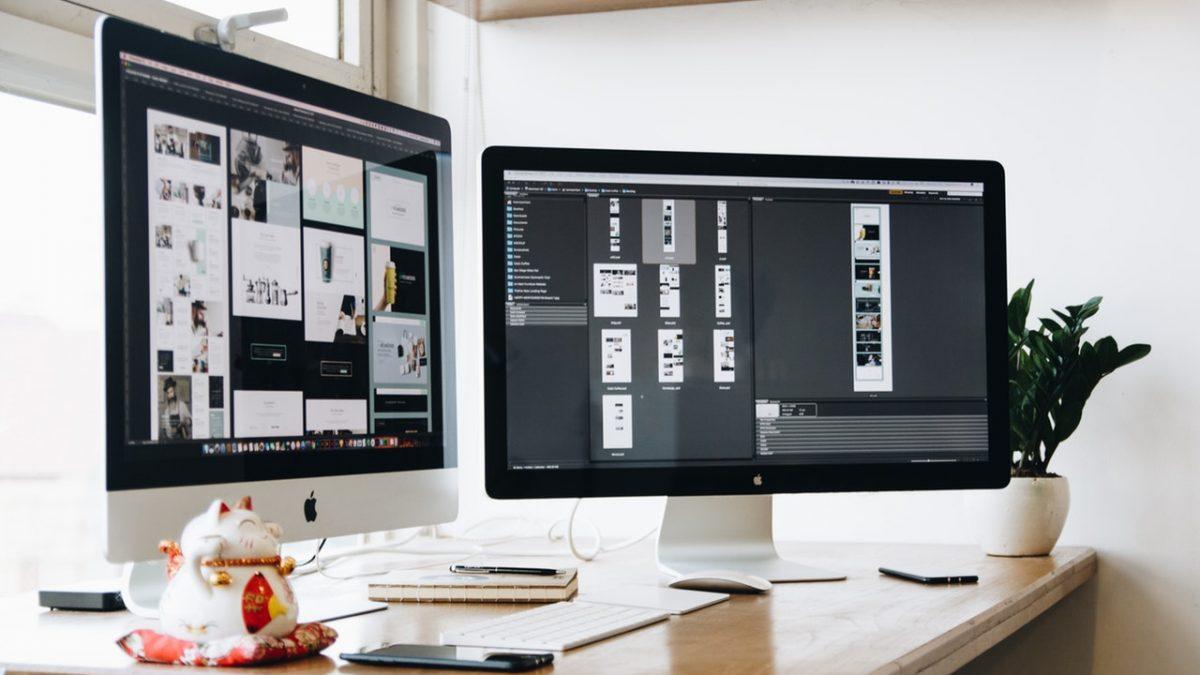 two white office desktops